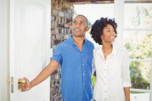 couple walking in door of home