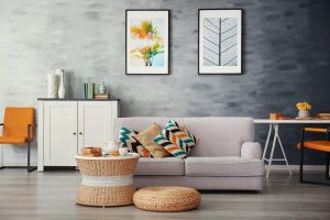 grey couch in living room clutter free
