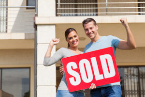 couple standing outside downtown Kelowna home