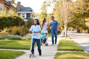 Family walking down the road in Kelowna
