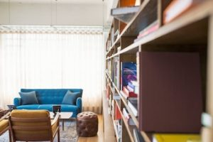 Kelowna downtown condo with bookshelf in living room