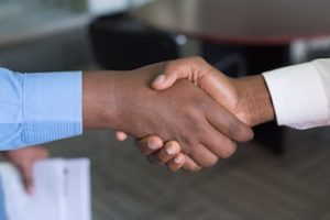 buyer and seller shaking hands on a deal