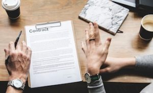 couple reviewing conditions on contract