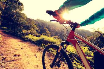person biking on a biking trail