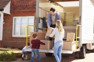 parents and son unloading moving truck