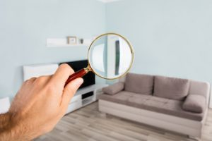 magnifying glass being held over a living room