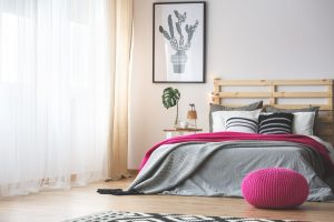 neutral bedroom with a pop of bright pink accents