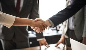 realtor shaking hands with client after purchase