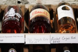 bottles of rose wine on shelf
