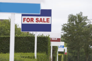 row of for sale signs-Quincy Vrecko and Associates-Kelowna Real Estate