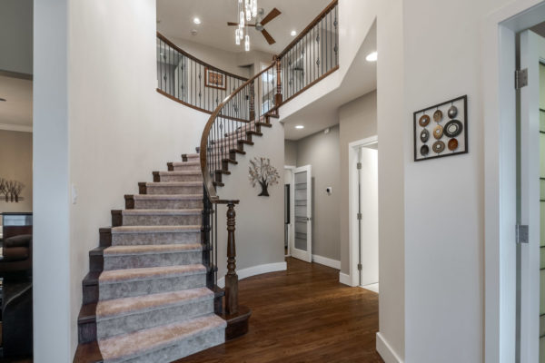 grand staircase Quincy Vrecko Kelowna Luxury Real Estate